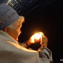 Prayers and candles on the Ganges at night.